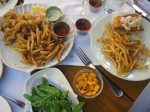 Fried clams, lobster roll, french fries, pea pods